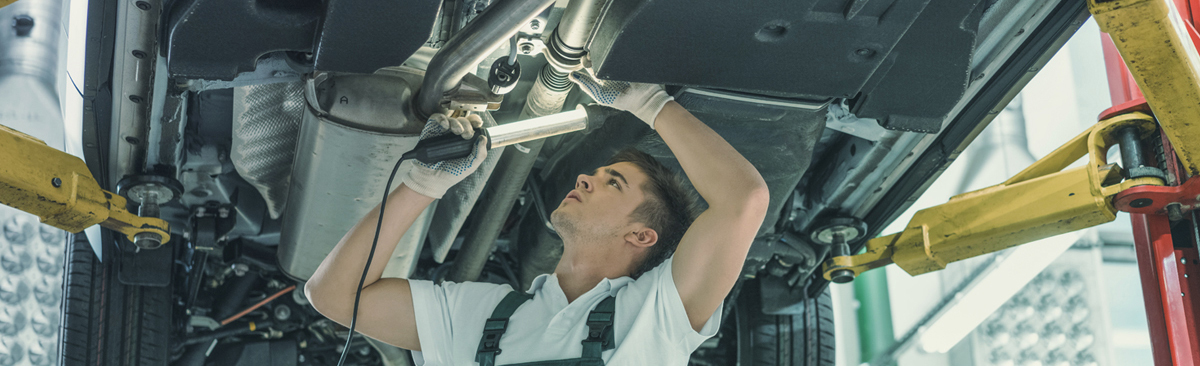 Mechanics servicing a vehicle - Car Servicing Fenland